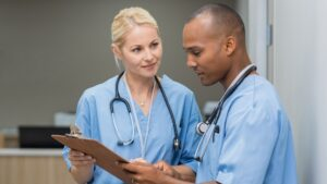 Medical staff reading chart